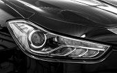 Closeup Headlights Of Car.
