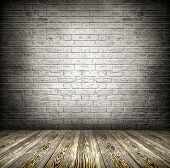 Background of age grungy black, white texture of paint stucco brick and stone wall with dark wood fl