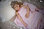 stock photo of blanket snow  - Composite image of high angle portrait of cute girl resting on sofa against snow - JPG