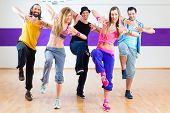 picture of dancing  - Group of men and women dancing fitness choreography in dance school - JPG