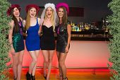 stock photo of hen party  - Laughing friends having a hen party against green fir branches - JPG
