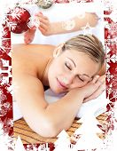 picture of tapping  - Attractive woman receiving a tapping massage against christmas themed frame - JPG