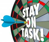 picture of diligent  - Stay on Task 3d words on a dart board to illustrate being diligent and completing a job - JPG