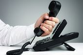 picture of telemarketing  - Businessman on business landline telephone in an office concept for communication - JPG