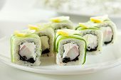 Постер, плакат: Cucumber Maki Sushi Roll made of Crab Meat Cream Cheese and Black Tobiko inside Cucumber outsid