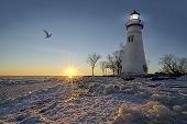 picture of marblehead  - The historic Marblehead Lighthouse in Northwest Ohio sits along the rocky shores of the frozen Lake Erie - JPG