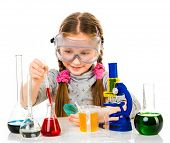 happy little girl with flasks for chemistry isolated on a white background poster