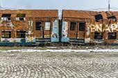 picture of train-wheel  - Rusty train wagons in a train station near Bucharest waiting insurance evaluation - JPG