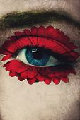 stock photo of  eyes  - closeup of woman blue eye with red flower added around eye as well as texture - JPG