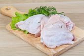 pic of thighs  - Raw chicken thighs with salad leaves and ruccola - JPG
