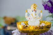 stock photo of hindu-god  - Ganesha Hindu God statue on tray with pedestal  - JPG