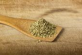 foto of oregano  - Oregano in a wooden spoon over wood background - JPG