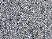 stock photo of granite  - gray gravel of smooth granite and marble stones - JPG