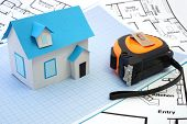 stock photo of construction  - Model house and tape measure on construction plan - JPG