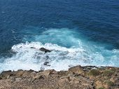 pic of breaker  - The rocks and the wave breakers of the Atlantic ocean at  Punto de Paso Chico on the island Fuerteventura in Spain - JPG