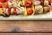 pic of braai  - BBQ Grilled Mixed With Vegetables Pork Kebabs On The Wooden Cutting Board - JPG