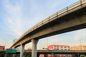 picture of passenger train  - Sky train railway cement construction in Bangkok with sky and city - JPG