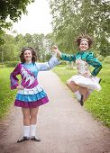 image of wig  - Two young beautiful girls in irish dance dress and wig dancing outdoor