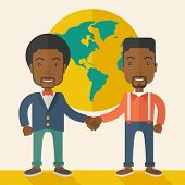 stock photo of partnership  - A two black guy happily handshaking with their International or global world corporation business - JPG