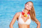stock photo of hawaiian flower  - Portrait of beautiful happy woman on the beach - JPG