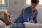 image of older men  - Older ill man with nasal cannula sleeping in hospital bed