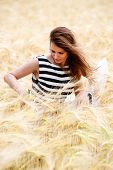 pic of dry grass  - gorgeous girl walking in the field of long grass and dragging her hand touching the dry grass while laughing and smiling carefree healthy lifestyle - JPG