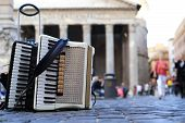 pic of accordion  - Accordion and harmonica in the background of Pantheon in Rome - JPG