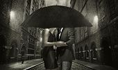 pic of rainy season  - Elegant couple on rainy evening - JPG