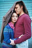 picture of amor  - Amorous couple in casualwear covered by jacket - JPG