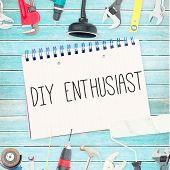 picture of enthusiastic  - The word diy enthusiast against tools and notepad on wooden background - JPG