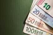 picture of ten  - Contemporary euro banknotes on green background - JPG