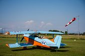 pic of biplane  - light aircraft modern biplane orange and blue details and takeoff - JPG