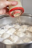 stock photo of boiling water  - Fish ball on the boiled water inside the pan - JPG