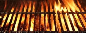 stock photo of charcoal  - Flaming Empty BBQ Charcoal Grill Background Texture - JPG