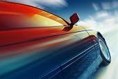 picture of icy road  - Blurred car on icy road with sky - JPG