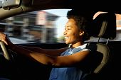 Happy Young African Woman Driving A Car poster