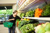 foto of grocery-shopping  - Woman shopping in produce section - JPG