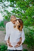 Happy Husband And His Pregnant Wife Is Waiting Impatiently Their Baby. poster