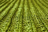 image of villi  - Sparkling green knit macro focus on the central part of it - JPG