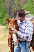 foto of cowboy  - Cowboy working his horse in the field - JPG