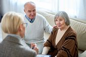 Anonymous Therapist Having Meeting With Elderly Patients In Nursing Home Giving Consultation. poster