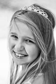 Small Girl Kid With Long Blonde Hair And Pretty Smiling Happy Face In Dress And Prom Princess Crown  poster