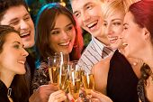foto of christmas party  - Image of friends having fun together at a party - JPG