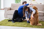 Happy family with golden retriever dog poster