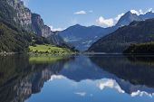 Mountain Lake Klontalersee  On Background Of Majestic Mountains Reflected In The Water And Bright Cl poster