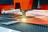 Automatic Plasma Cutting Machine Cuts Steel Sheet. poster