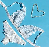 Lace White Lingerie, Panties, Bra, Pearl Necklace On Blue Background, Lingerie, Still Life, Flatlay poster