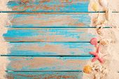 Beach Background - Top View Of Beach Sand With Shells, Starfish On Wood Plank In Blue Sea Paint Colo poster