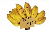 foto of eat me  - Banana with the sign eat me on the paper on white background ready for use - JPG