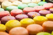 Assortment Of Colorful Macarons For Sale In Shop. Rows Of Macaroons In Candy Shop, Storefront With S poster